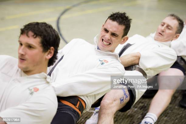 A competitor from the England 'B' Tug of War squad grimaces as he competes with his team during the 600 and 680 kilo international categories during...