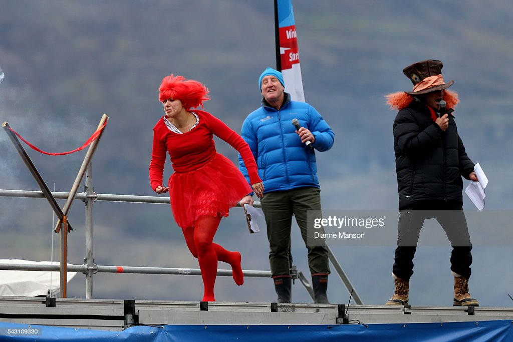 A competitor gets ready to dive off the wharf during the American Express Queenstown Winter Festival Hits 90.4 Birdman competition on June 26, 2016 in Queenstown, New Zealand.