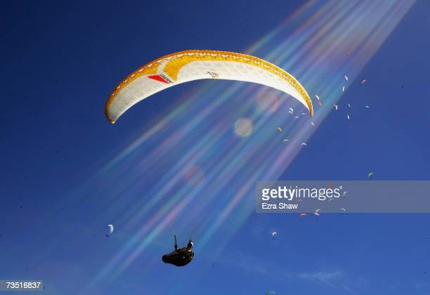 A competitor glides through the sky during the 10th FAI Paragliding World Championships on March 7 2007 in Manila Australia