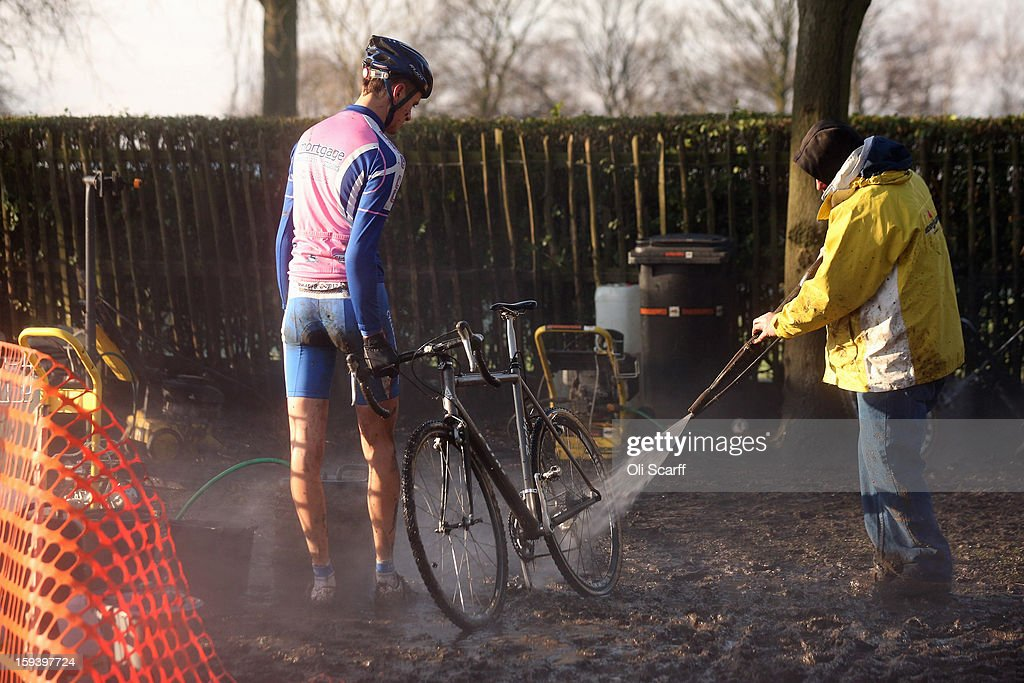 A competitor has his bike pressure-washed after taking part in the 'Mens Under 23' category race at the 2013 National Cyclo-Cross Championships in Peel Park on January 13, 2013 in Bradford, England. The sport of cyclo-cross, featuring ,lightweight bikes with off-road tyres, has dramatically increased in popularity over the past few years. Cyclo-cross courses are often run over a mixture of terrains from tarmac to mud and frequently include obstacles or steep inclines where riders have to carry their bike.