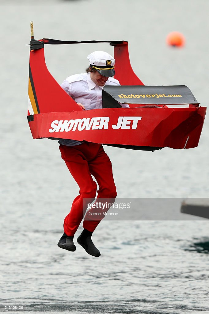 A competitor in a cupboard shotover jet dives off the wharf during the American Express Queenstown Winter Festival Hits 90.4 Birdman competition on June 26, 2016 in Queenstown, New Zealand.