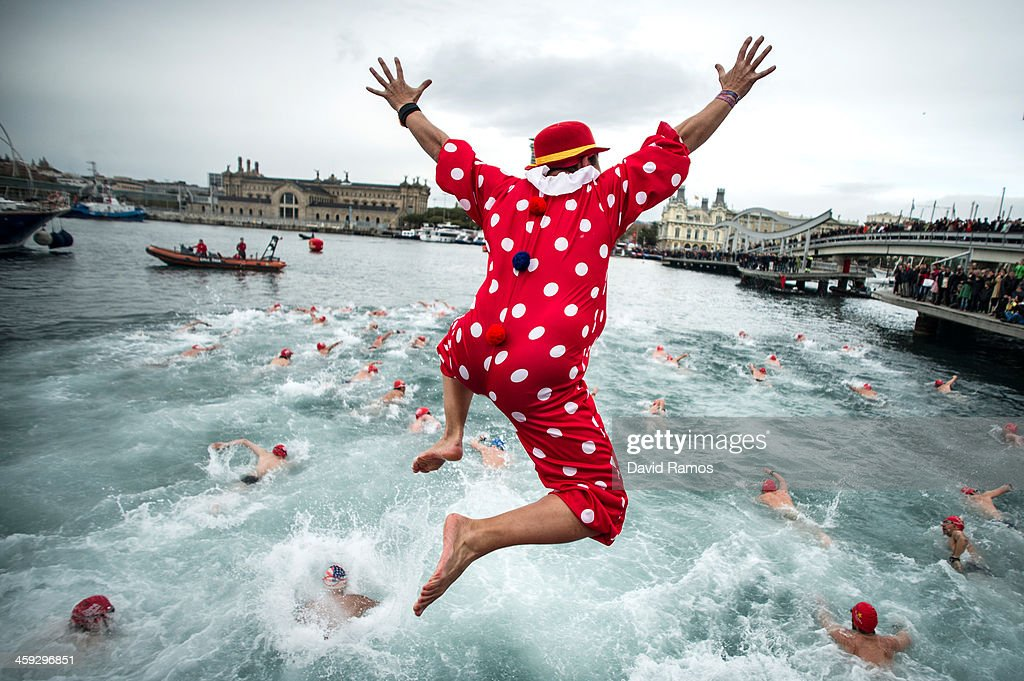 A competitor in Christmas fancy dress jumps into the sea during the 104rd Barcelona Traditional Christmas Swimming Cup at the Old Harbour of Barcelona on December 25, 2013 in Barcelona, Spain. The Copa Nadal is organised by the Barcelona Swimming Club and involves competitors swimming across some 200 metres of water in the harbour. Launched in 1908 the event has only been suspended three times when the Spanish Civil War interrupted proceedings between 1936 and 1938.