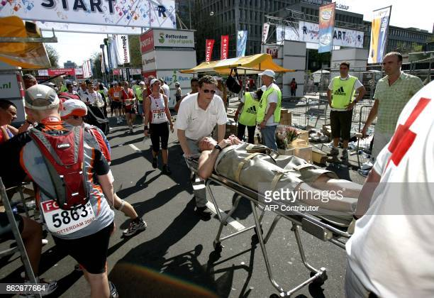 A competitor in the Rotterdam Marathon is wheeled away on an ambulance stretcher 15 April 2007 during the race in Rotterdam Kenya's Joshua Chelanga...