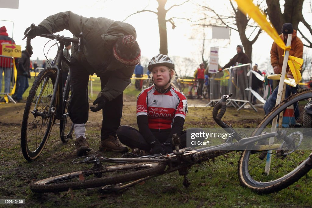 A competitor in the 'Youth Under 14' category rests after taking part the 2013 National Cyclo-Cross Championships in Peel Park on January 12, 2013 in Bradford, England. The sport of cyclo-cross, featuring lightweight bikes with off-road tyres, has dramatically increased in popularity over the past few years. Cyclo-cross courses are often run over a mixture of terrains from tarmac to mud and frequently include obstacles or steep inclines where riders have to carry their bike.