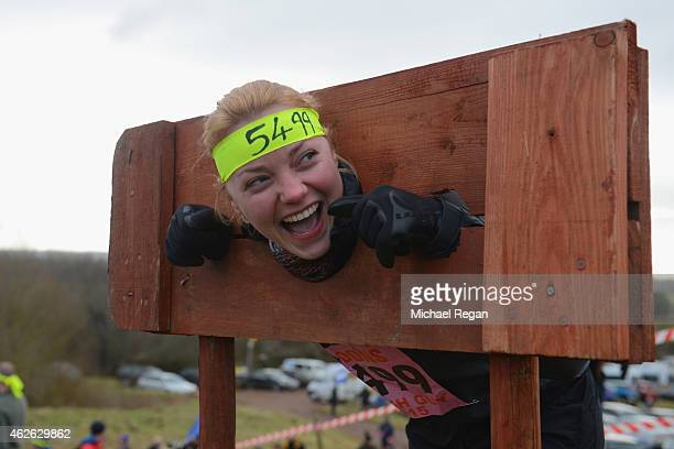 A competitor is placed in the stocks ahead of the annual Tough Guy Challenge race on February 1 2015 in Telford England