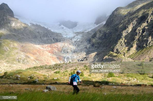 A competitor is seen during the Ultra Trial race a 163km race around the Mont Blanc crossing France Italy and Swiss on August 27 2011 near the Lac...