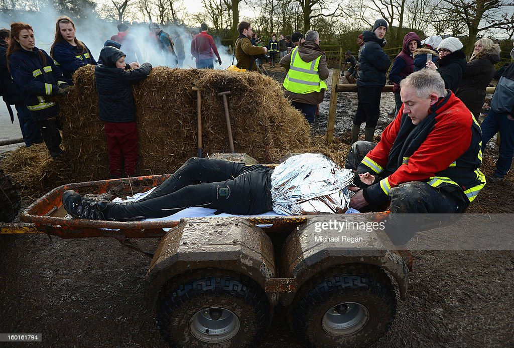 A competitor is taken away by medics during the Tough Guy Challenge endurance race on January 27, 2013 in Telford, England. Every year thousands of people run the 8 mile assault course which involves freezing temperatures, fire and ice.