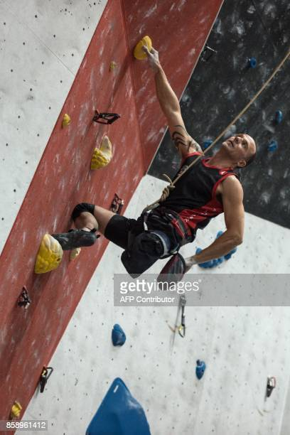 Competitor Ivan German Pascual of Spain competes in the English stage of the IFSC Paraclimbing Cup at the Awesome Walls climbing centre in Sheffield...