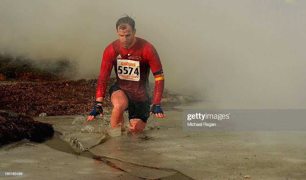 A competitor jumps into icy water during the Tough Guy Challenge endurance race on January 27, 2013 in Telford, England. Every year thousands of people run the 8 mile assault course which involves freezing temperatures, fire and ice.