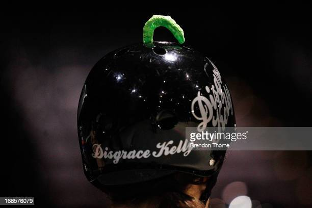 A competitor keeps her mouth guard atop of her helmet during Bout One of the Sydney Roller Derby League on May 11 2013 in Sydney Australia The...