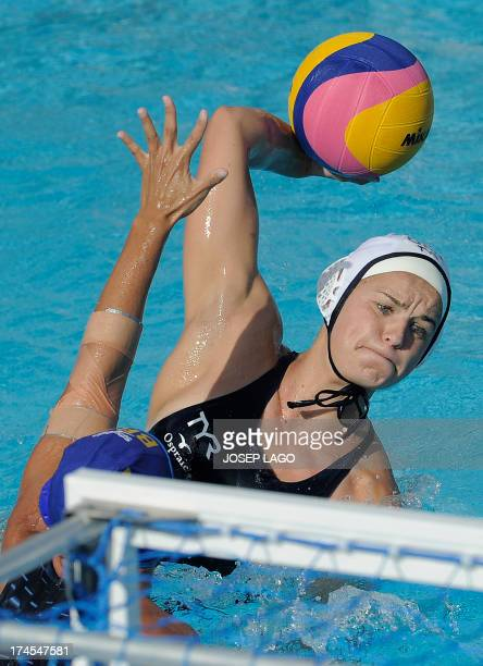 US competitor KileyNeushul is held back by Brazil's Lucianne Maia during the preliminary rounds of the women's water polo at the FINA World...