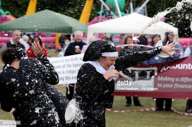 Competitor Lauren Schroder takes part in the World Custard Pie Championships at Coxheath Village Hall in Kent