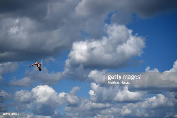 A competitor makes a practice dive prior to the Men's High Diving 27m preliminary round on day ten of the 16th FINA World Championships at the...