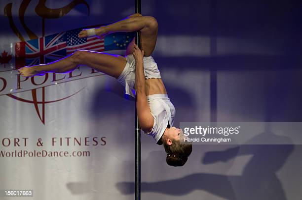 A competitor participates at the World Pole Dancing Championship 2012 held at the Volkshaus on November 10 2012 in Zurich Switzerland The public's...