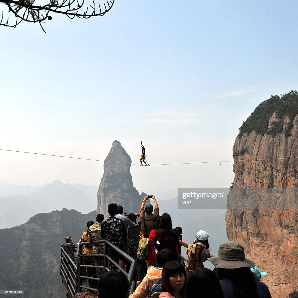 Competitor performs slackline during China's first worldwide high altitude slackline challenge on October 19, 2014 in Taizhou, Zhejiang province of China.