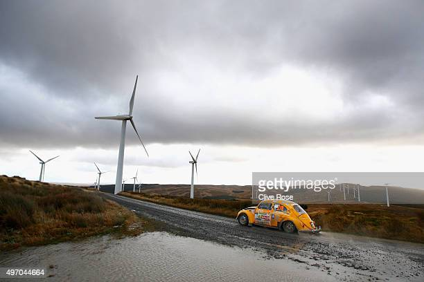A competitor pilots a vintage VW Beetle through the Myherin stage of the FIA World Rally Championship Great Britain on November 13 2015 in Pont...