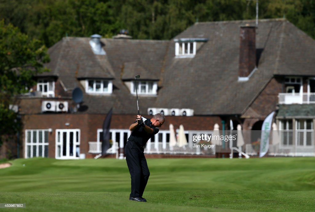A competitor plays an approach shot during the Golfplan Insurance PGA Pro-Captain Challenge - North (West) Regional Qualifier at Dunham Forest Golf and Country Club on August 22, 2014 in Altrincham, England.