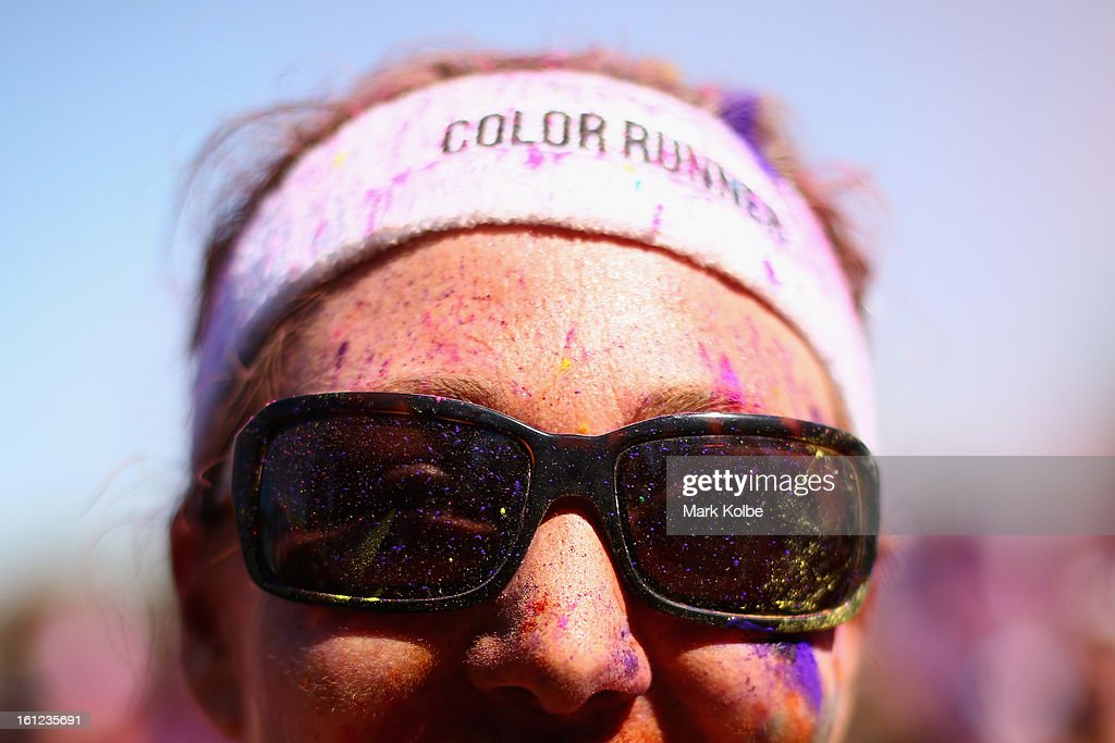 A competitor poses after finishing the Colour Run at Sydney Olympic Park on February 10, 2013 in Sydney, Australia.