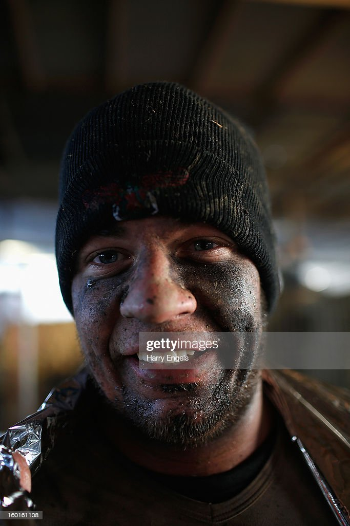 A competitor poses for a portrait after completing the Tough Guy Challenge on January 27, 2013 in Telford, England.
