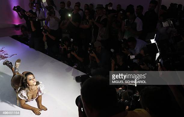 A competitor poses on the catwalk during the Miss Bumbum Brazil 2015 pageant in Sao Paulo Brazil on November 9 2015 Fifteen candidates compete in the...