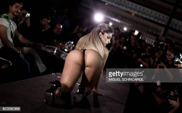 A competitor poses on the catwalk during the Miss Bumbum Brazil 2016 pageant in Sao Paulo Brazil on November 9 2016 Fifteen candidates compete in the...