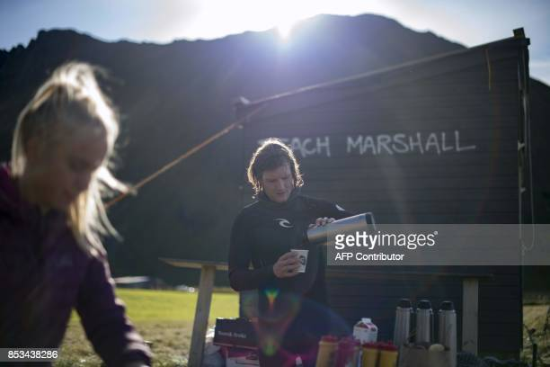 A competitor prepares a hot drink during the Lofoten Masters 2017 the world's most northerly surf competition in Unstad's bay in the arctic circle on...
