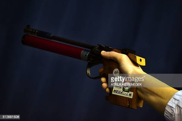 A competitor prepares his shoot during his practice session in AUDI Arena of Gyor on February 26 2016 prior to the qualification round of 10m air...