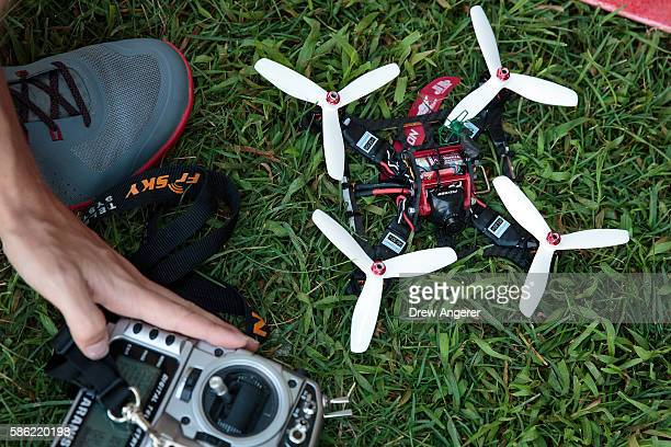 A competitor prepares to fly his drone during practice day at the National Drone Racing Championships on Governors Island August 5 2016 in New York...