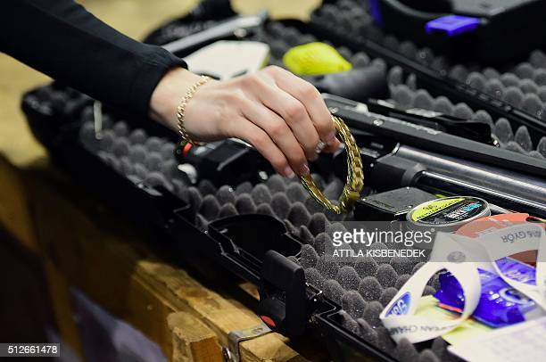 A competitor puts her watch to prepare a practice session in AUDI Arena of Gyor on February 26 2016 prior to the qualification round of 10m air rifle...