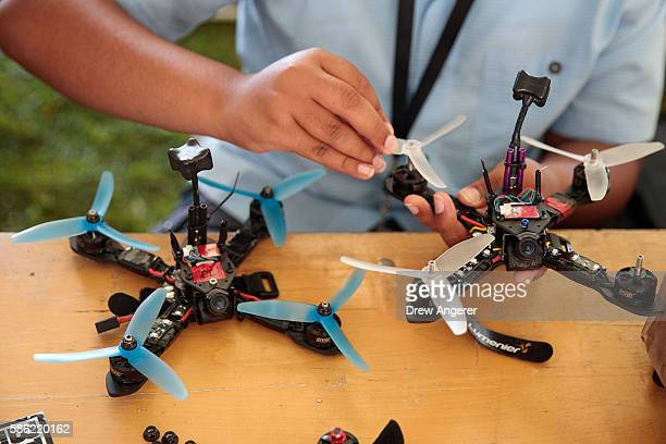 A competitor puts the finishing touches on his drone during practice day at the National Drone Racing Championships on Governors Island August 5 2016...