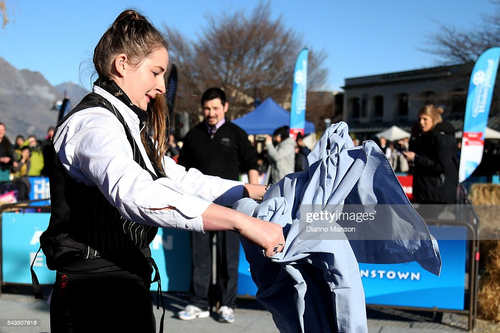 A competitor races to make a bed in the Hospitality race during the Queenstown Winter Festival on June 29, 2016 in Queenstown, New Zealand.