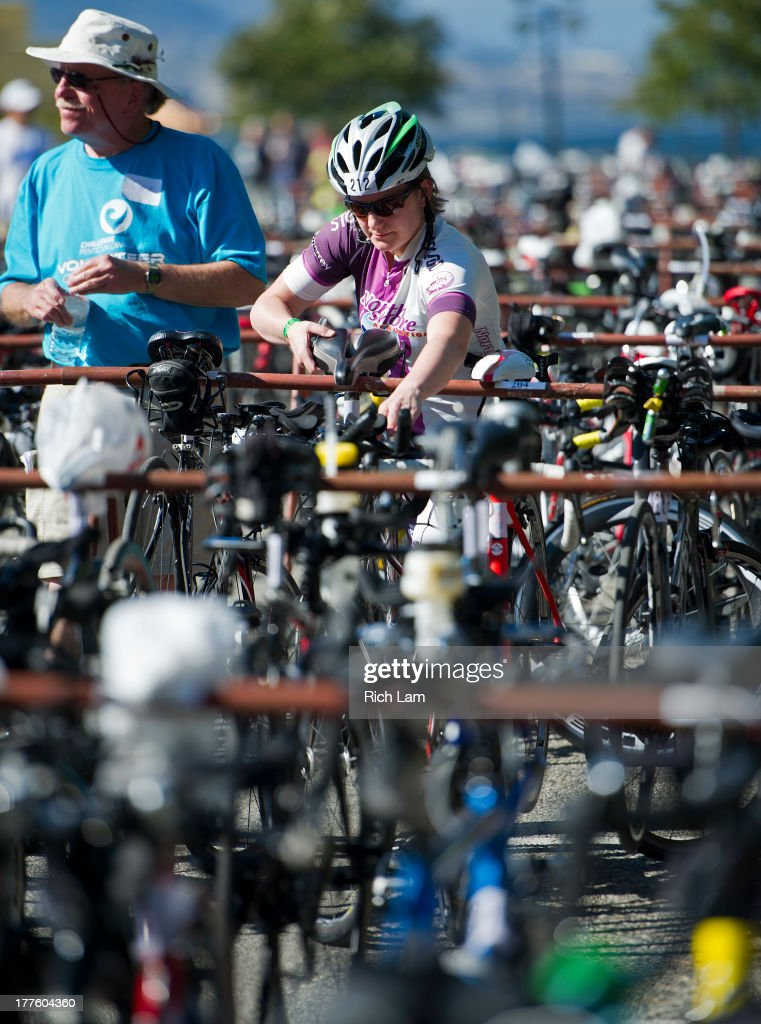 A competitor racks her bike during the Challenge Penticton Triathlon previews on August 24, 2013 in Penticton, British Columbia, Canada.