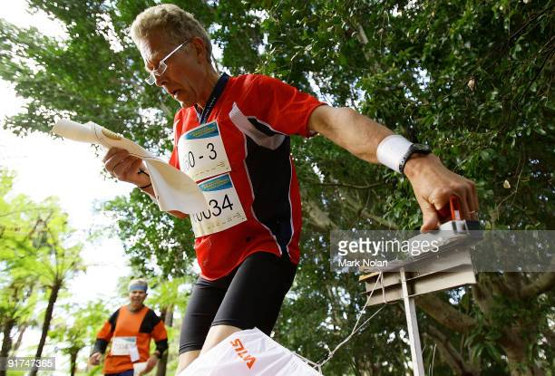 A competitor reads his map as he arrives at a control point during the mens Orienteering during day two of the 2009 Sydney World Masters Games at...