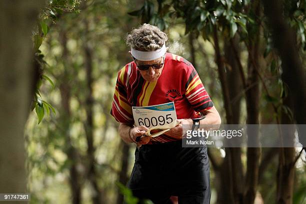 A competitor reads his map during the mens Orienteering during day two of the 2009 Sydney World Masters Games at Sydney Olympic Park on October 11...
