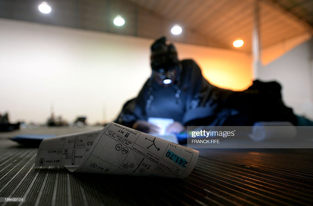A competitor reads his road book in Cachi after the Stage 7 of the Dakar 2013 between Calama and Salta, Argentina, on January 11, 2013. The rally takes place in Peru, Argentina and Chile from January 5-20.