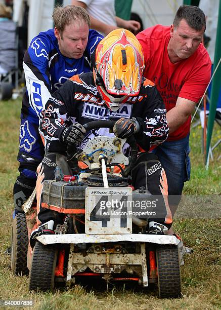 A competitor receives a push during the British Lawn Mower Racing Double 4 Hour race for Class 2 3 and 4 mower types at Bucks Green on June 12 2016...