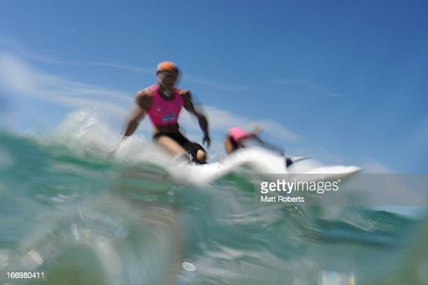 A competitor rides a wave during day three of the 2013 Australian National Surf Lifesaving Titles on April 19 2013 on the Gold Coast Australia