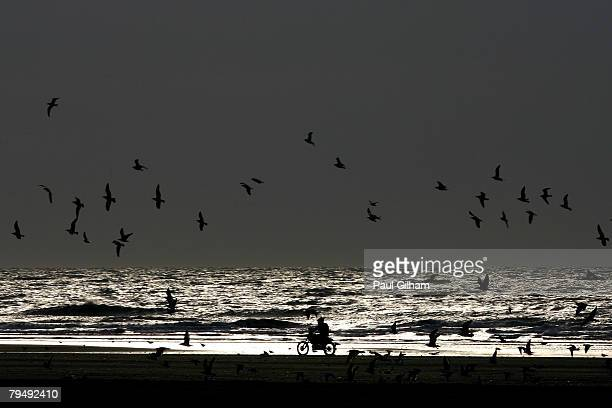 Competitor rides by the shore during the 155 kilometre circuit during the Enduropale race featuring 1000 motorbikes in the 3rd Enduropale du Touquet...