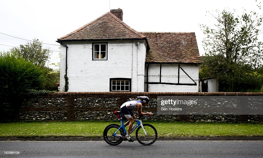 A competitor rides past a cottage on the cycle leg during the Challenge Henley-on-Thames Triathlon on September 16, 2012 in London, England.