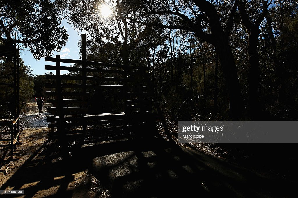 A competitor runs as he competes in the Tough Bloke Challenge at the Cataract Scout Park on June 30, 2012 in Sydney, Australia.
