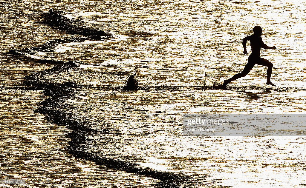 A Competitor runs into the water in the swim race during the Victorian Surf Lifesaving Championships on March 10, 2013 in Anglesea, Australia.