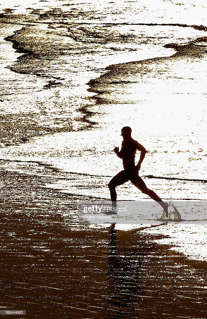 A Competitor runs out of the water in the swim race during the Victorian Surf Lifesaving Championships on March 10, 2013 in Anglesea, Australia.