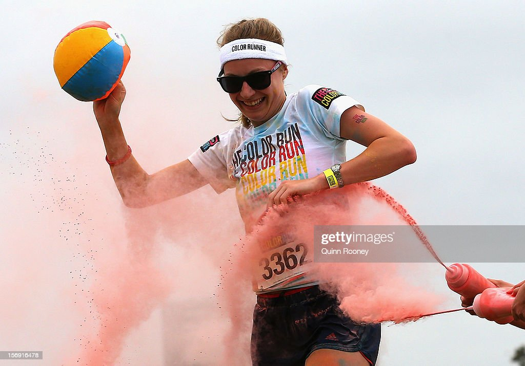 A competitor runs through the pink colour station during the Colour Run on November 25, 2012 in Melbourne, Australia.