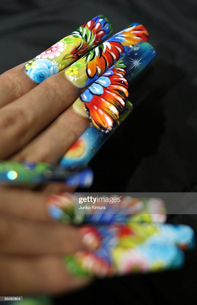 A competitor shows her nails during the Tokyo Nail Expo 2009 at Tokyo Big Sight on November 30, 2009 in Tokyo, Japan. The nail industry has grown to nearly 200 million Japanese yen market in 2008 and the annual event attracts 50,000 visitor.