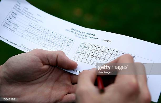Competitor signs his scorecard during the final round of the Skins PGA Fourball Championship at Forest Pines Hotel Golf Club on October 5 2012 in...