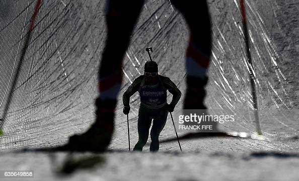 TOPSHOT A competitor skies during the Men 20 km Individual event at the FIS Biathlon World Championships in Hochfilzen on February 16 2017 / AFP /...