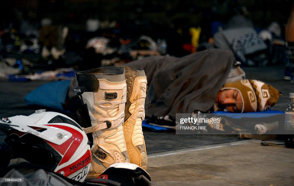 A competitor sleeps in Cachi after the Stage 7 of the Dakar 2013 between Calama and Salta, Argentina, on January 11, 2013. The rally will take place in Peru, Argentina and Chile January 5-20.