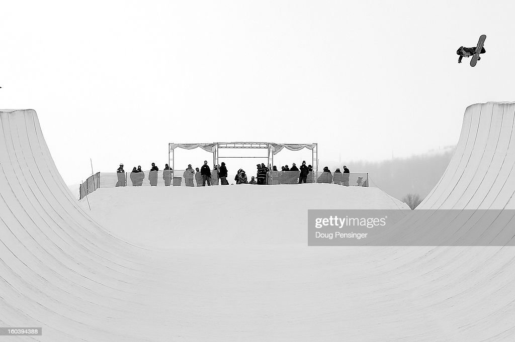 A competitor soars above the halfpipe during qualifications fro the FIS Snowboard Halfpipe World Cup at the Sprint U.S. Grand Prix at Park City Mountain on January 30, 2013 in Park City, Utah.