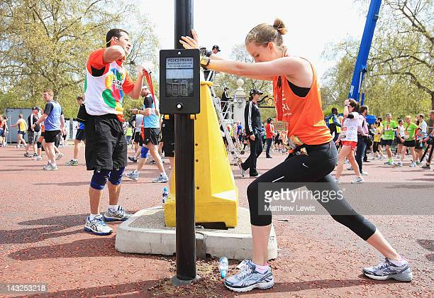 A competitor stretches after completing the Virgin London Marathon 2012 on April 22 2012 in London England