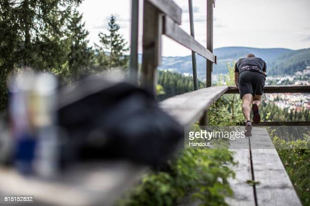 A competitor stretches next to the 400 metre skijump at Hochfirstschanze during the Red Bull 400 World Championship at TitiseeNeustadt Germany on...
